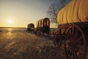 A picture of Mormon Pioneer Covered Wagons at sunrise.