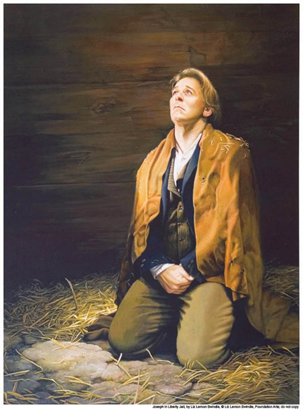 A painting of Mormon prophet Joseph Smith in Liberty Jail on his knees praying.