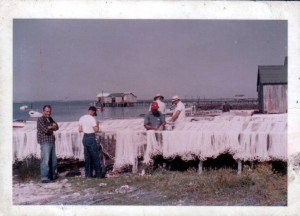 A picture of fishermen mending nets at the Landing on Harkers Island in the 1960s.