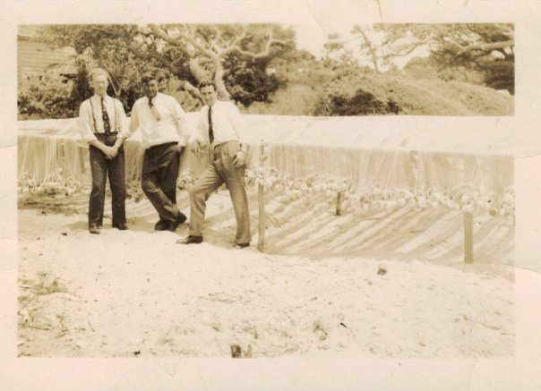 A picture of Telford Willis in front of net spreads with Mormon Elders in 1945 on Harkers Island.