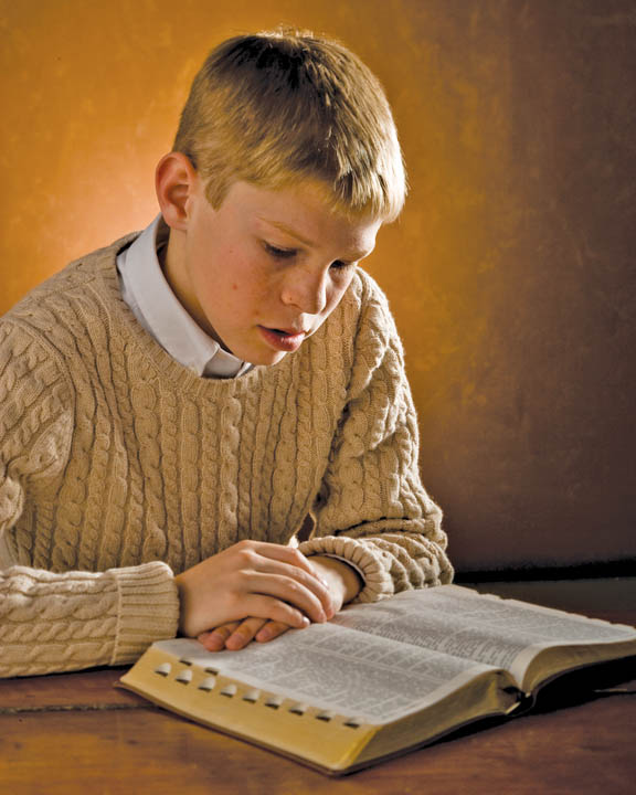 Mormon teenager studying Doctrine and Covenants