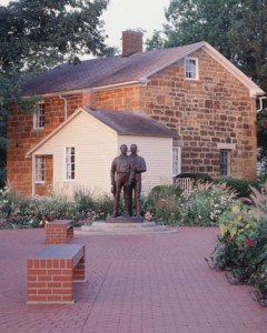 A picture of Carthage jail showing statues of Joseph Smith and Hyrum Smith where they were martyred and died at the hands of a mob.