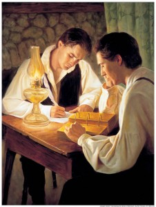 A painting of Joseph Smith Translating the Book of Mormon with Oliver Cowdery across the table from him as his scribe.
